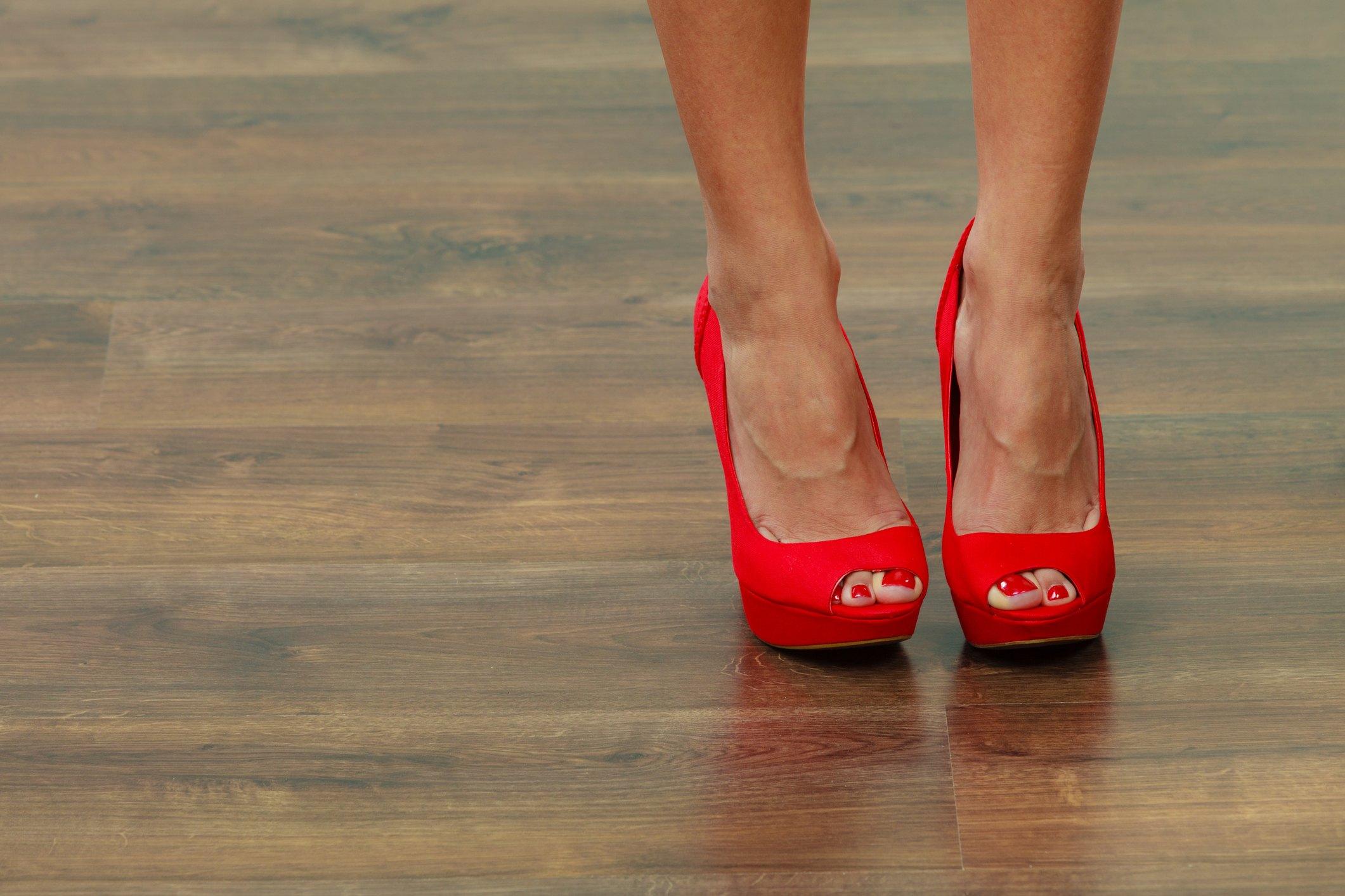 Red high heels on a wood floor