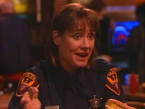 Jackie in a cops uniform