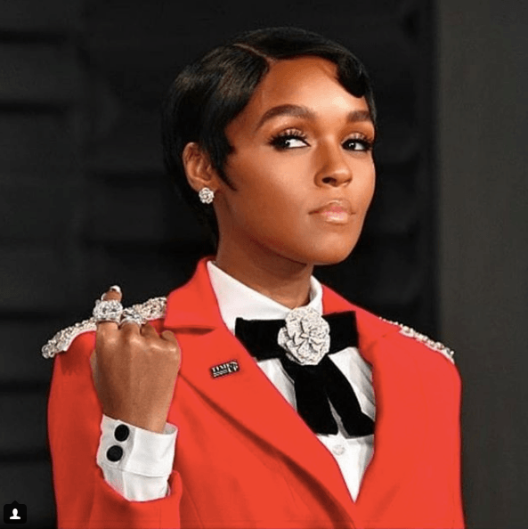 Janelle Monae in a red suit