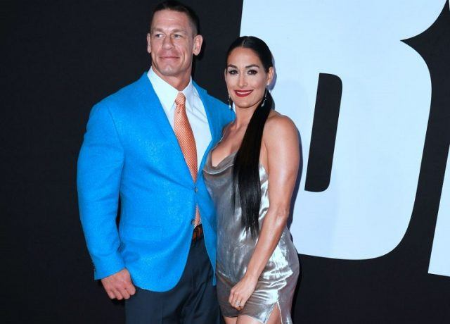 """John Cena and Nikki Bella arrive for the premiere of """"Blockers"""" in Los Angeles, California on April 3, 2018."""