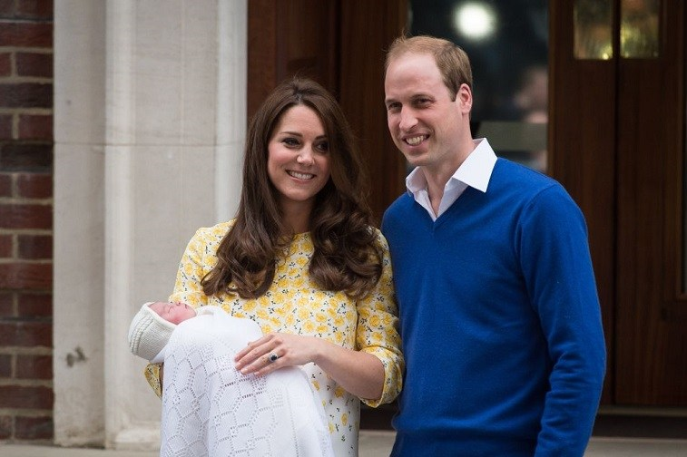 Britain's Prince William and Catherine, Duchess of Cambridge show their newly-born daughter, their second child, to the media outside the Lindo Wing at St Mary's Hospital in central London, on May 2, 2015.