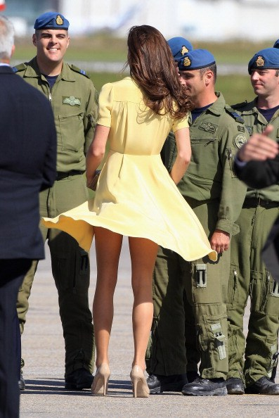 Catherine, Duchess of Cambridge speaks to soldiers as she arrives at Calgary Airport on July 7, 2011
