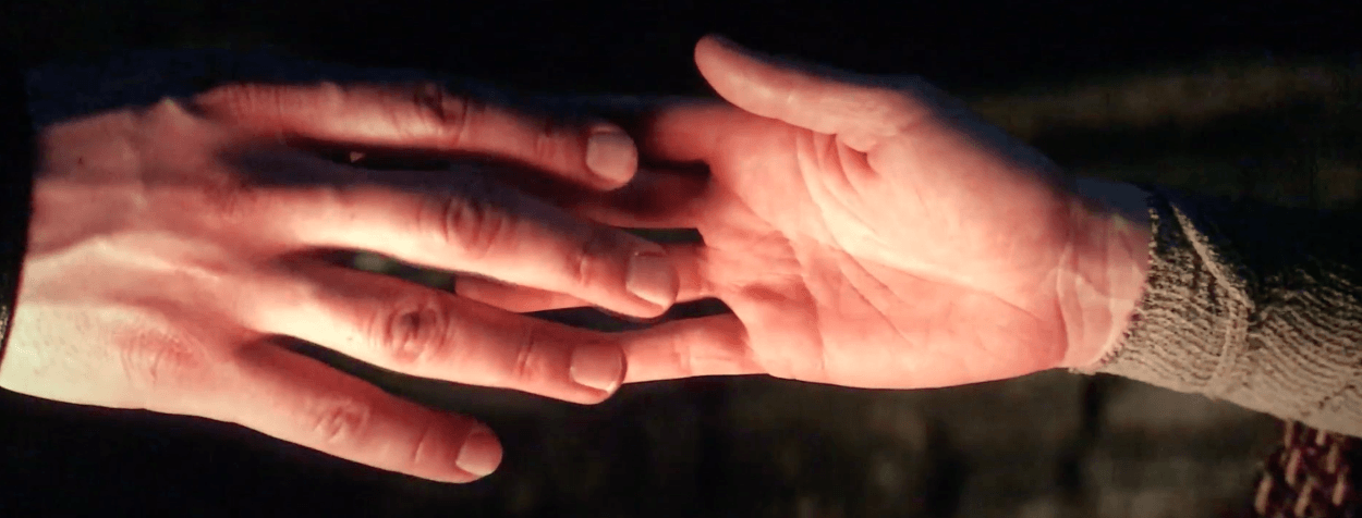 Kyle Ren and Rey touch hands in Star Wars: The Last Jedi