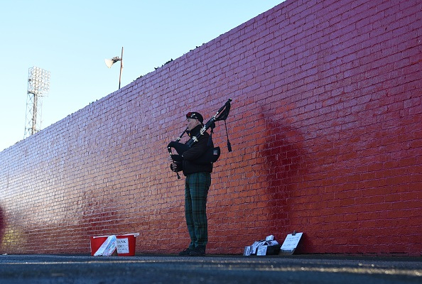 A man plays the bagpipes before the Sky Bet Championship match between Barnsley and Leeds United at Oakwell Stadium