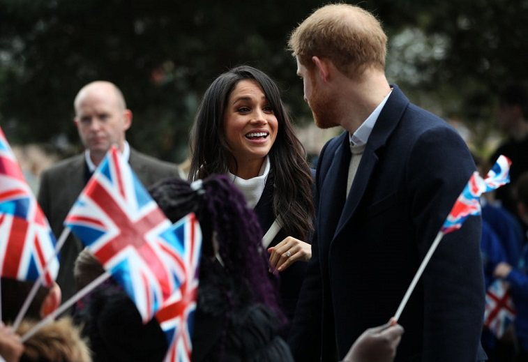 Prince Harry and Meghan Markle meet local school children during a visit to Birmingham on March 8, 2018 in Birmingham, England.
