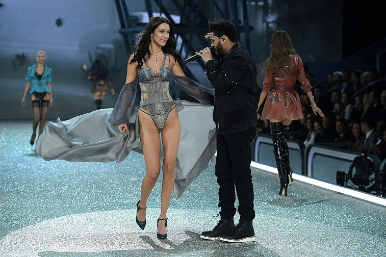 Bella Hadid walks the runway while The Weeknd performs during the 2016 Victoria's Secret Fashion Show on November 30, 2016 in Paris, France.
