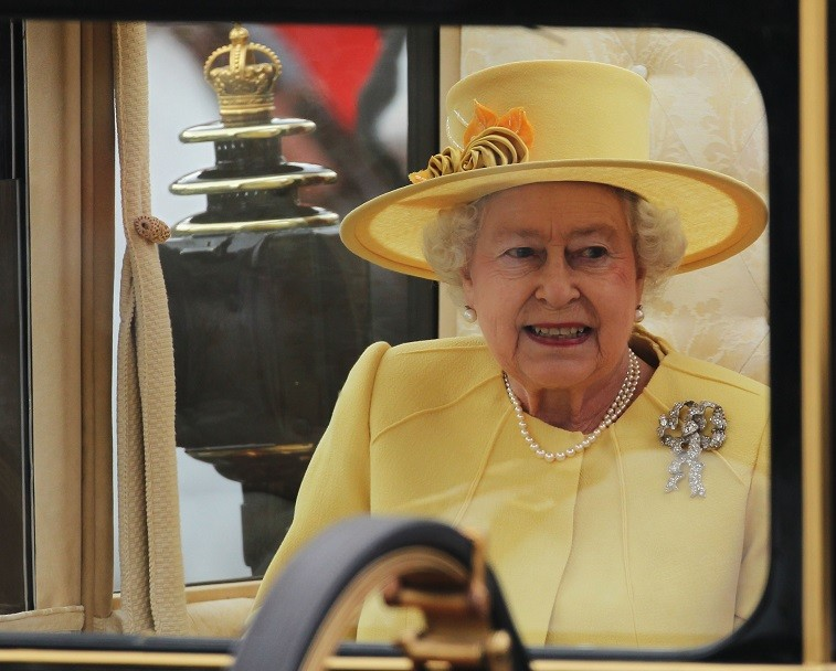 Queen Elizabeth II enters to ride in a carriage procession to Buckingham Palace