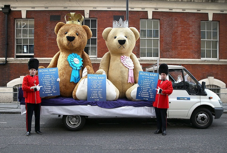 Two actors dressed as Guardsmen from a bookmakers hold up odds on the Royal Baby's name as the World's media wait for Catherine, Duchess of Cambridge to go into labour at St Mary's Hospital on May 1, 2015 in London, England. Catherine, Duchess of Cambridge is expected to give birth at the Lindo wing sometime in the next couple of weeks.