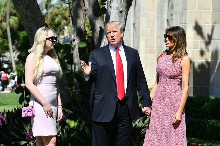 US President Donald Trump (C) with First Lady Melania Trump (R) and daughter Tiffany Trump (L) arrives for Easter service at the Church of Bethesda-by-the-Sea in Palm Beach, Florida, April 1, 2018.