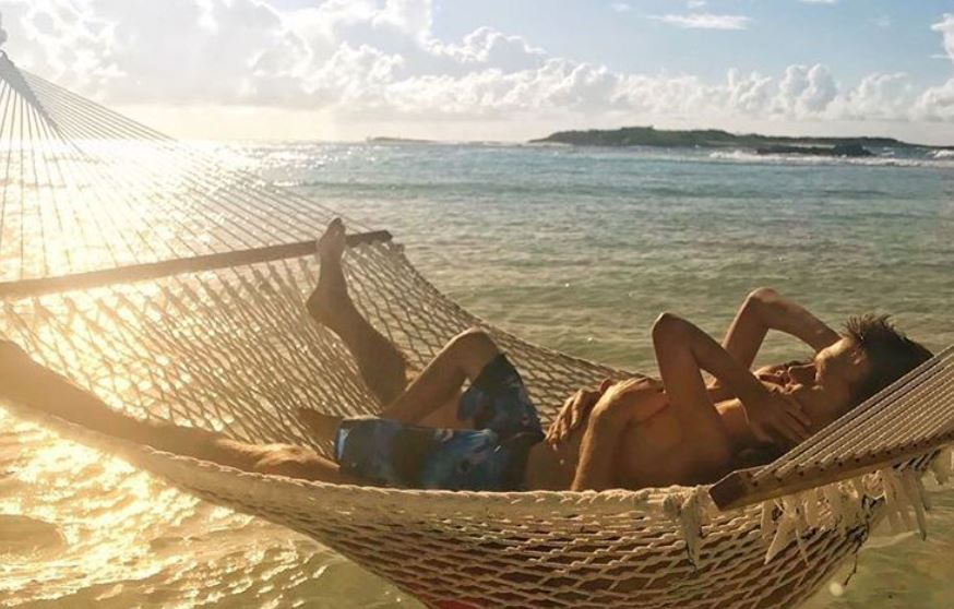 Tom Brady and his son on a hammock