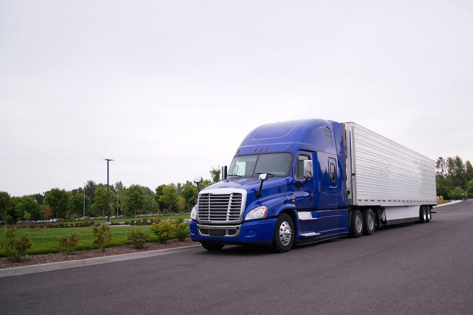 Bright blue modern popular huge comfortable big rig semi truck