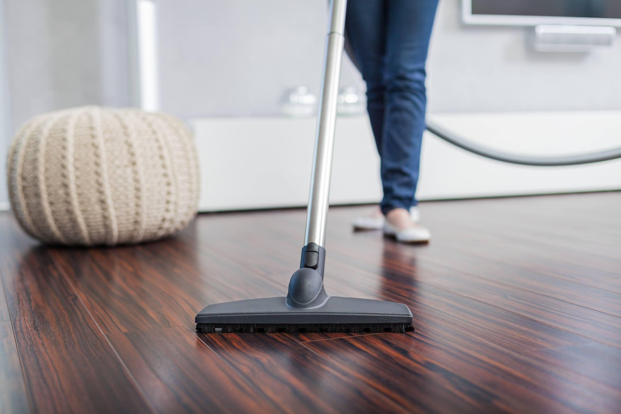 vacuuming a wood floor