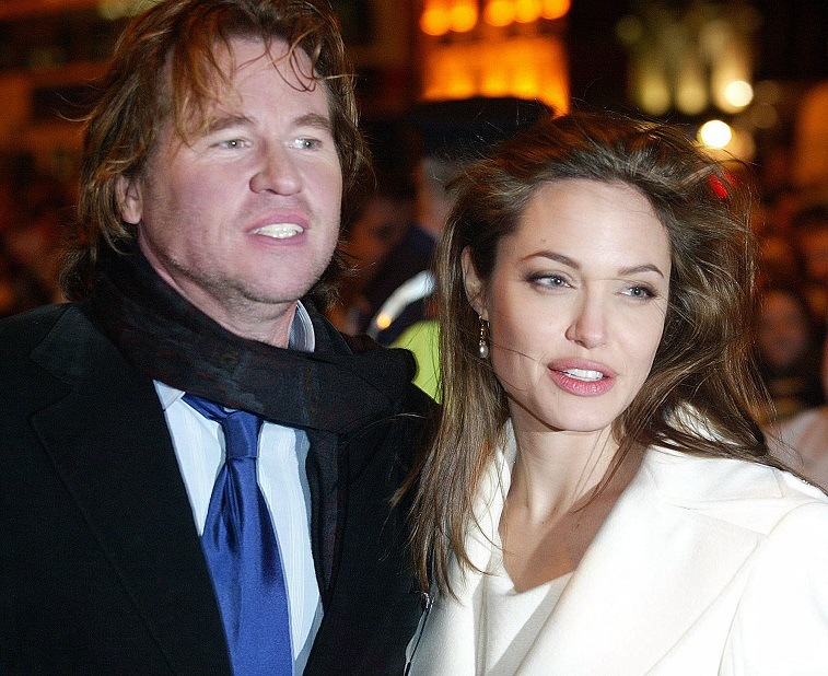 """Angelina Jolie and Val Kilmer arrive at the Irish Premiere of """"Alexander"""" at the Savoy Cinema on January 6, 2005 in Dublin, Ireland."""