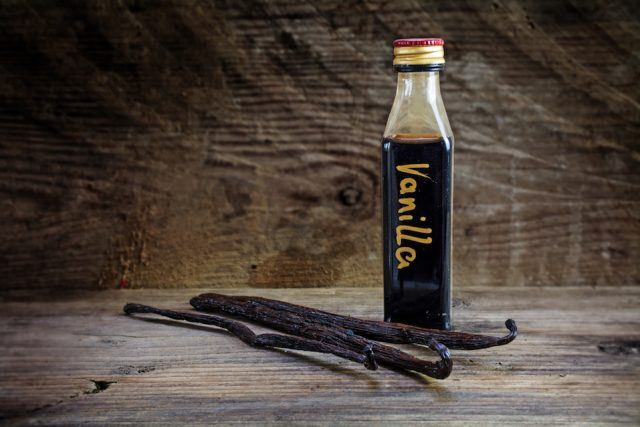 vanilla extract in a bottle and pods