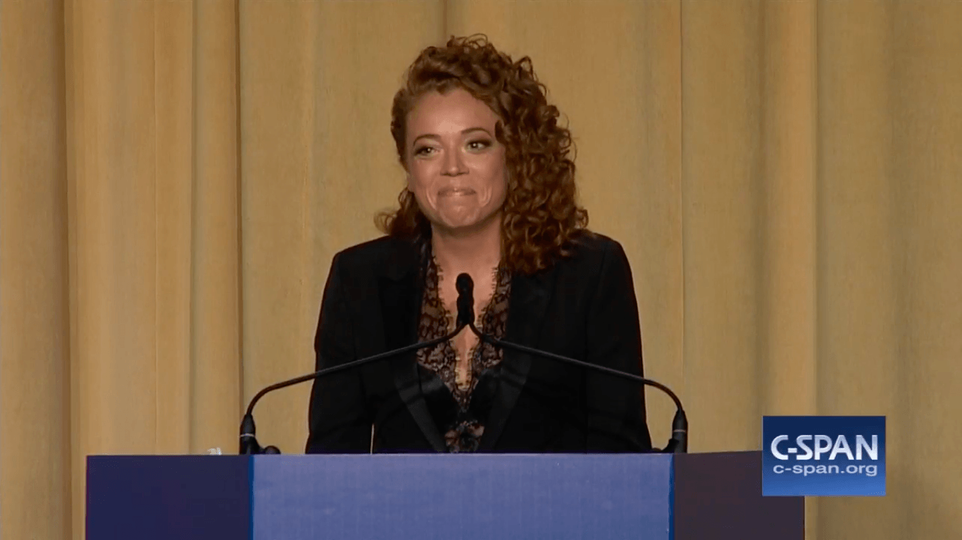 Michelle Wolf at a podium