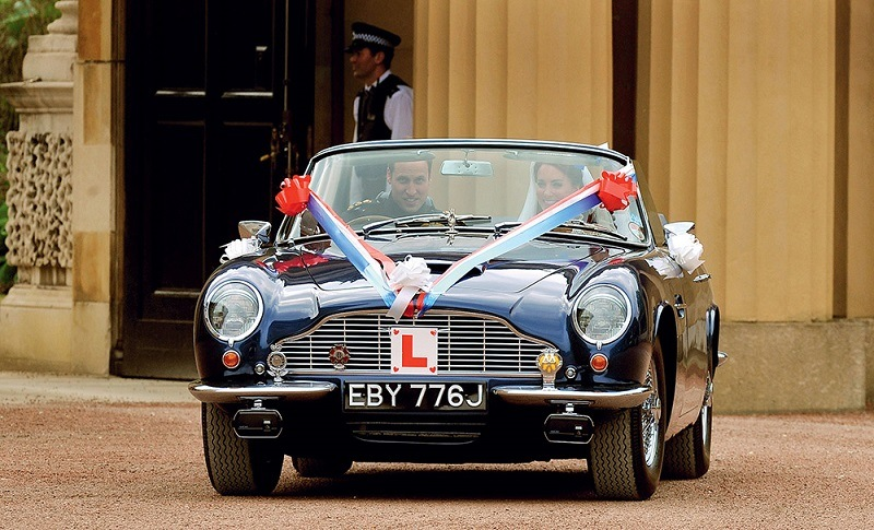 William and Kate in a blue Aston Martin at their wedding