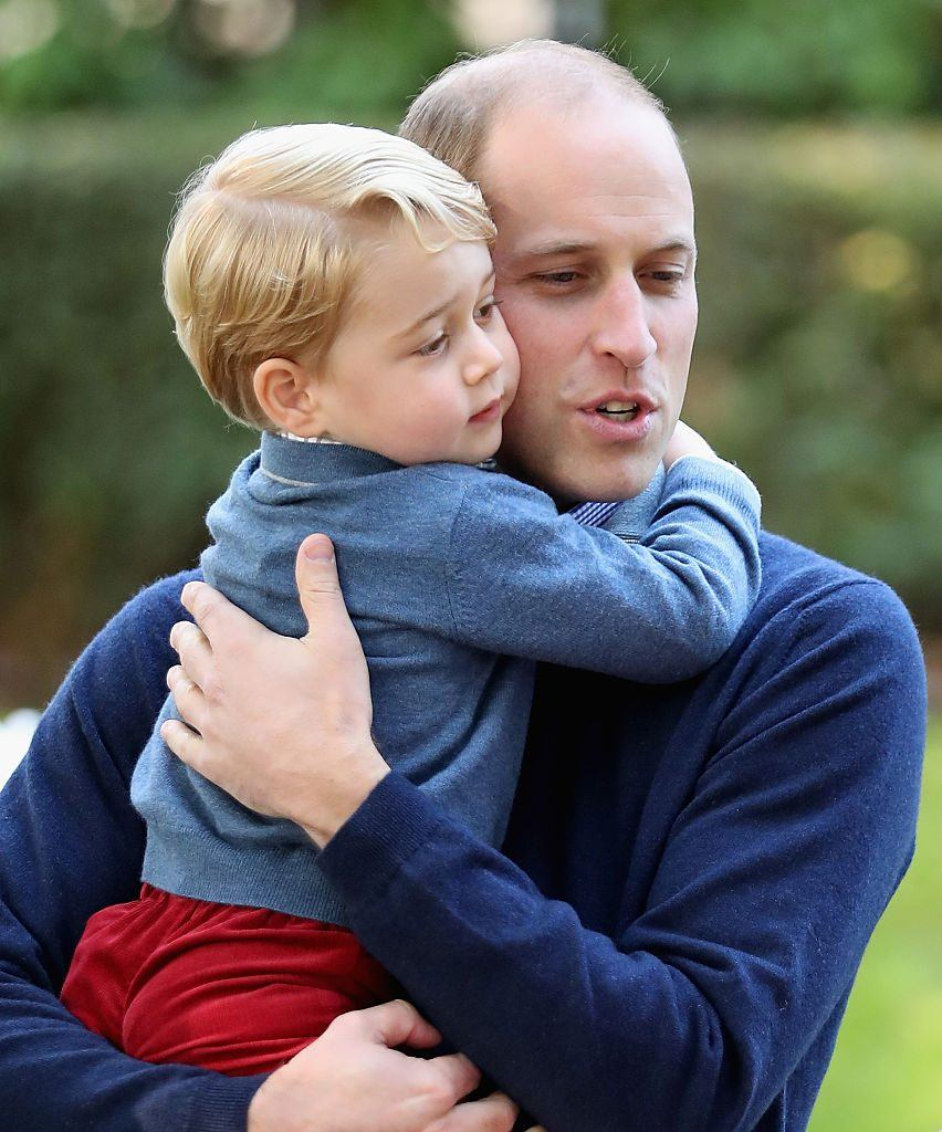 Prince George of Cambridge with Prince William, Duke of Cambridge at a children's party for Military families