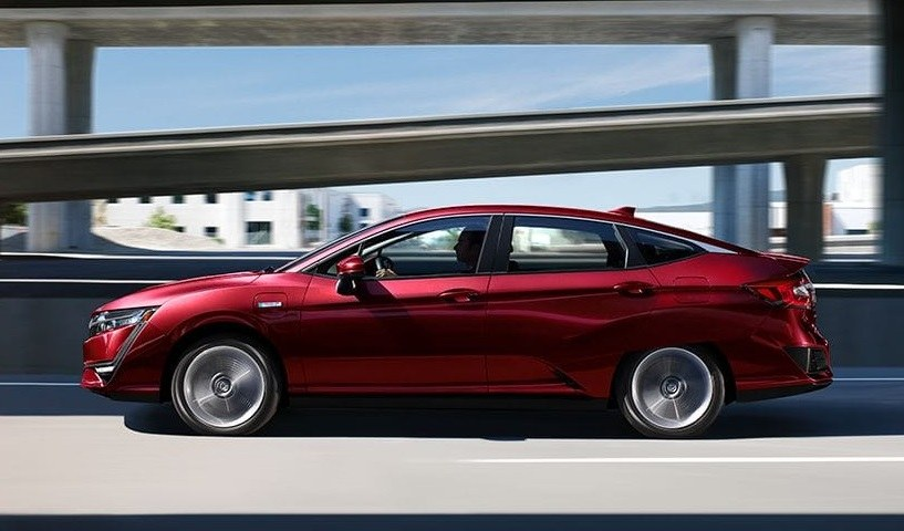 Red Clarity Plug-in Hybrid on the highway