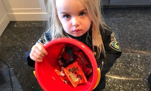Donald Trump Jr.'s daughter holding a bucket of candy