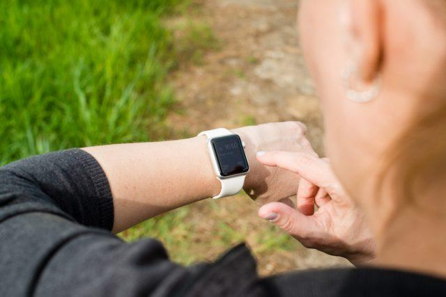 A woman using her Apple Watch.