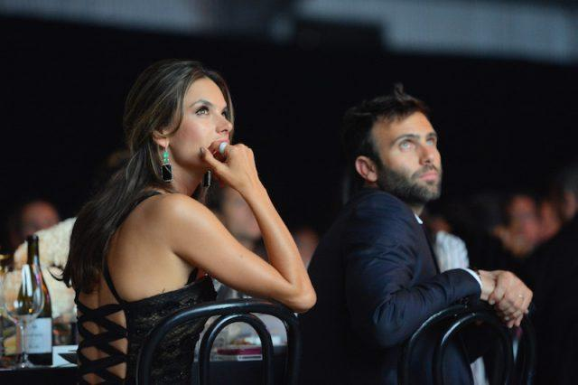 Alessandra Ambrosio and Jamie Mazu sitting together at a dinner.