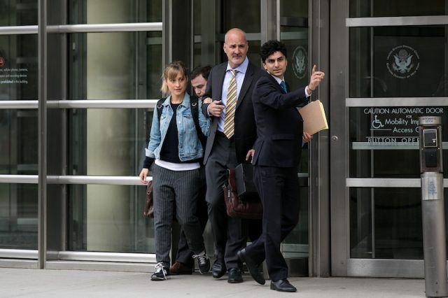 Allison Mack leaving the U.S Court District building.