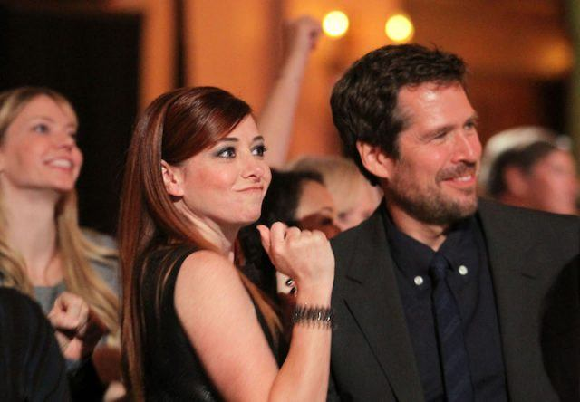 Alyson Hannigan and Alexis Denisof at a party together.
