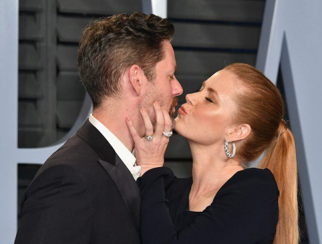 Darren Le Gallo and Amy Adams kissing for the paparazzi.