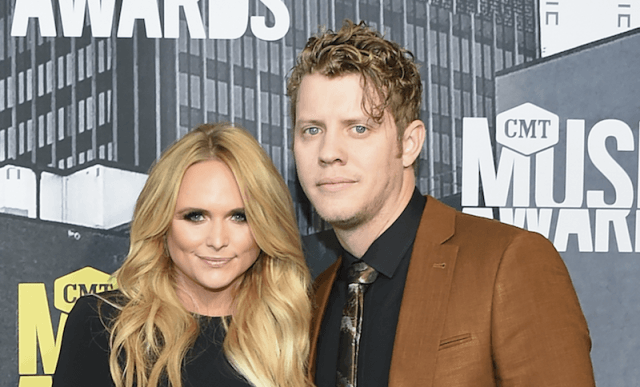 Miranda Lambert posing with Anderson East on a red carpet.