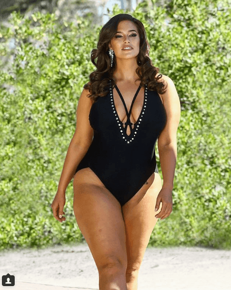 Ashley Graham in a black one-piece swimsuit