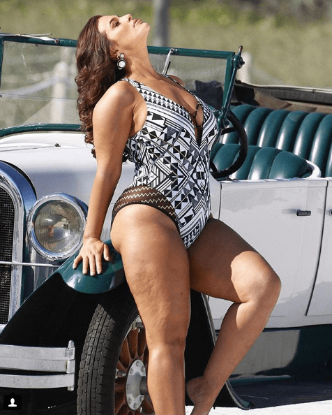 Ashley Graham modeling in a swimsuit