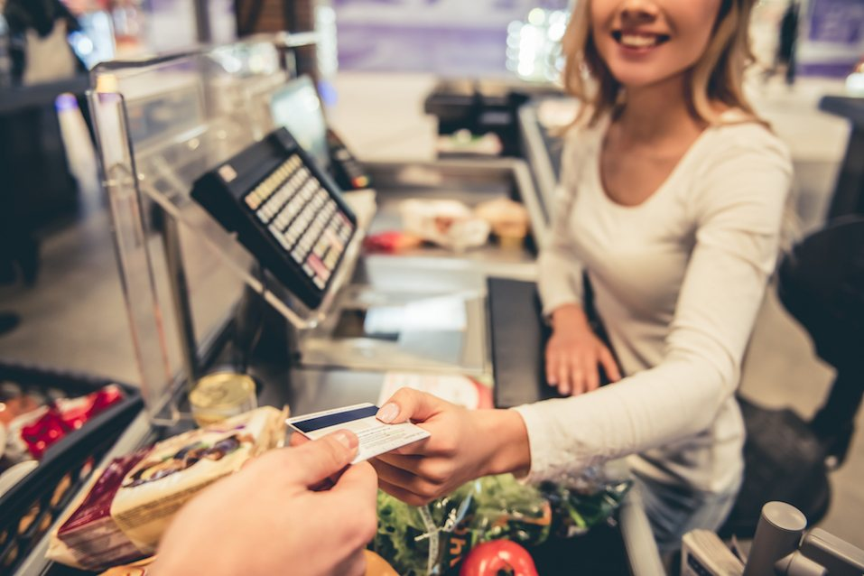 Woman paying for groceries