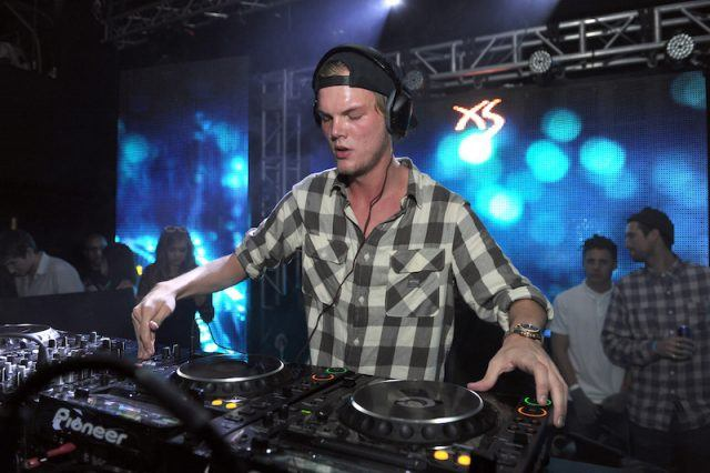 Avicii performing a set with his equipment.