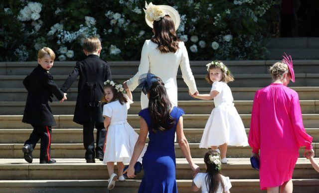 Britain's Catherine, Duchess of Cambridge walks up the west steps with Prince George and Princess Charlotte.