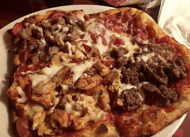 Bertucci's meat pizza on a plate.