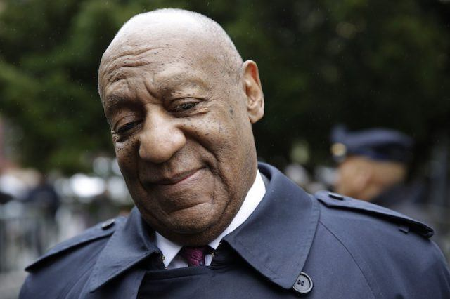 Bill Cosby standing outside a courthouse.