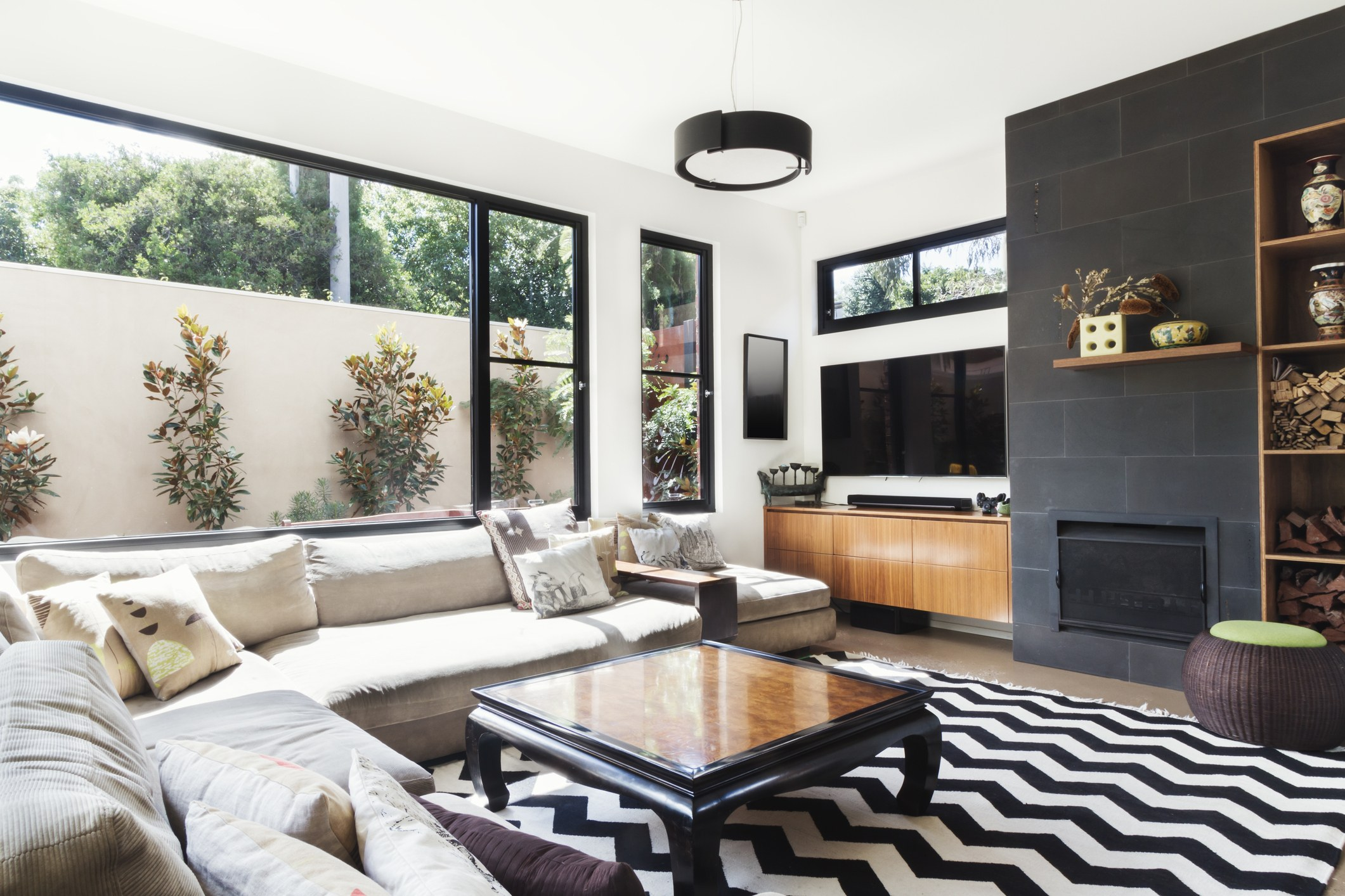 Monochrome living room with wood and black tiling accents