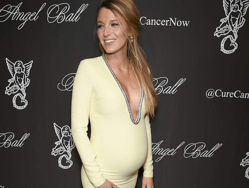 Blake Lively pregnant in a yellow dress at an event