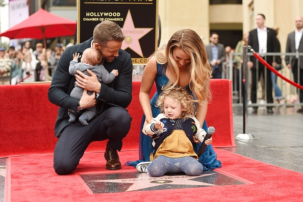Actors Ryan Reynolds (L) and Blake Lively pose with their daughters as Ryan Reynolds is honored with star on the Hollywood Walk of Fame
