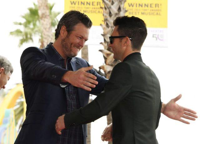 Blake Shelton and Adam Levine going in for a hug.