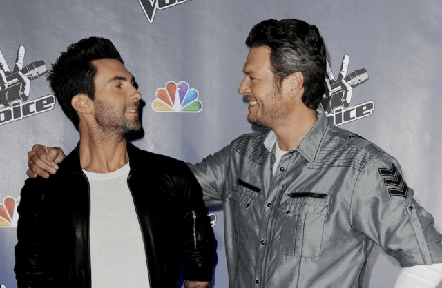 Blake Shelton wrapping an arm around Adam Levine.