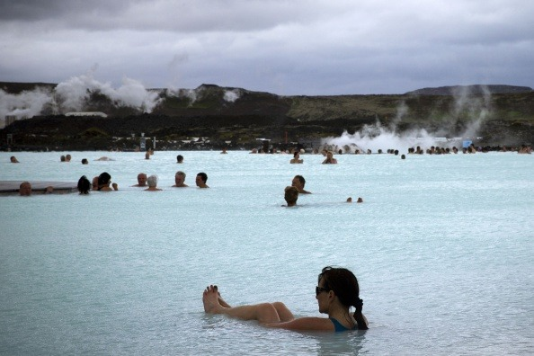 "People bath in the ""Blue lagoon "" geothermal spa, one of the most visited attractions in Iceland in the Reykjanes peninsula, southwestern Iceland on July 5, 2014. The spa is located on a lava field."