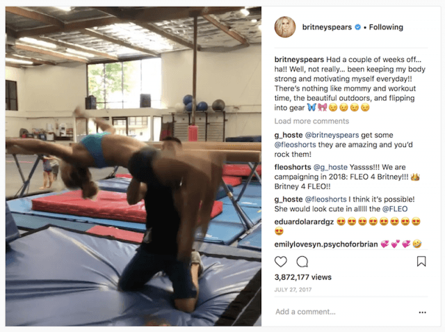 Britney Spears doing a backflip with her trainer.