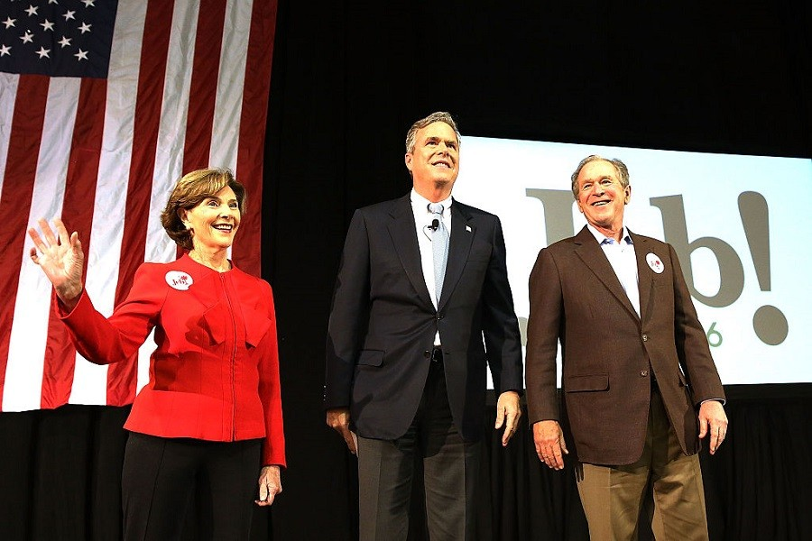 Jeb Bush (C) stands with his brother, former President George W. Bush (R) and former First Lady Laura Bush (L) at a campaign rally on February 15, 2016 in North Charleston, South Carolina.