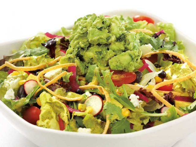 Guacamole salad in a white bowl.
