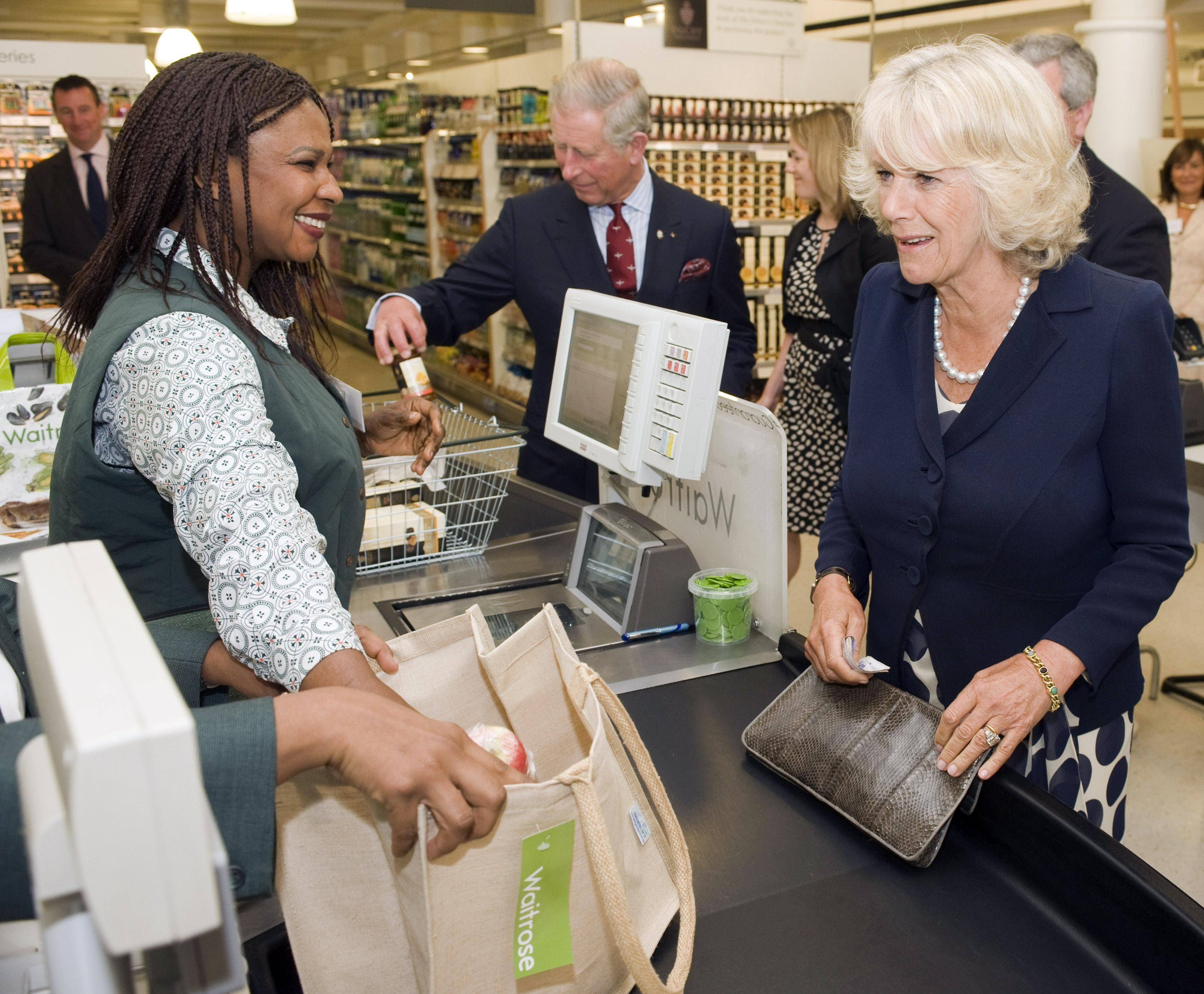 Camilla Parker Bowles and Prince Charles checking out at grocery store