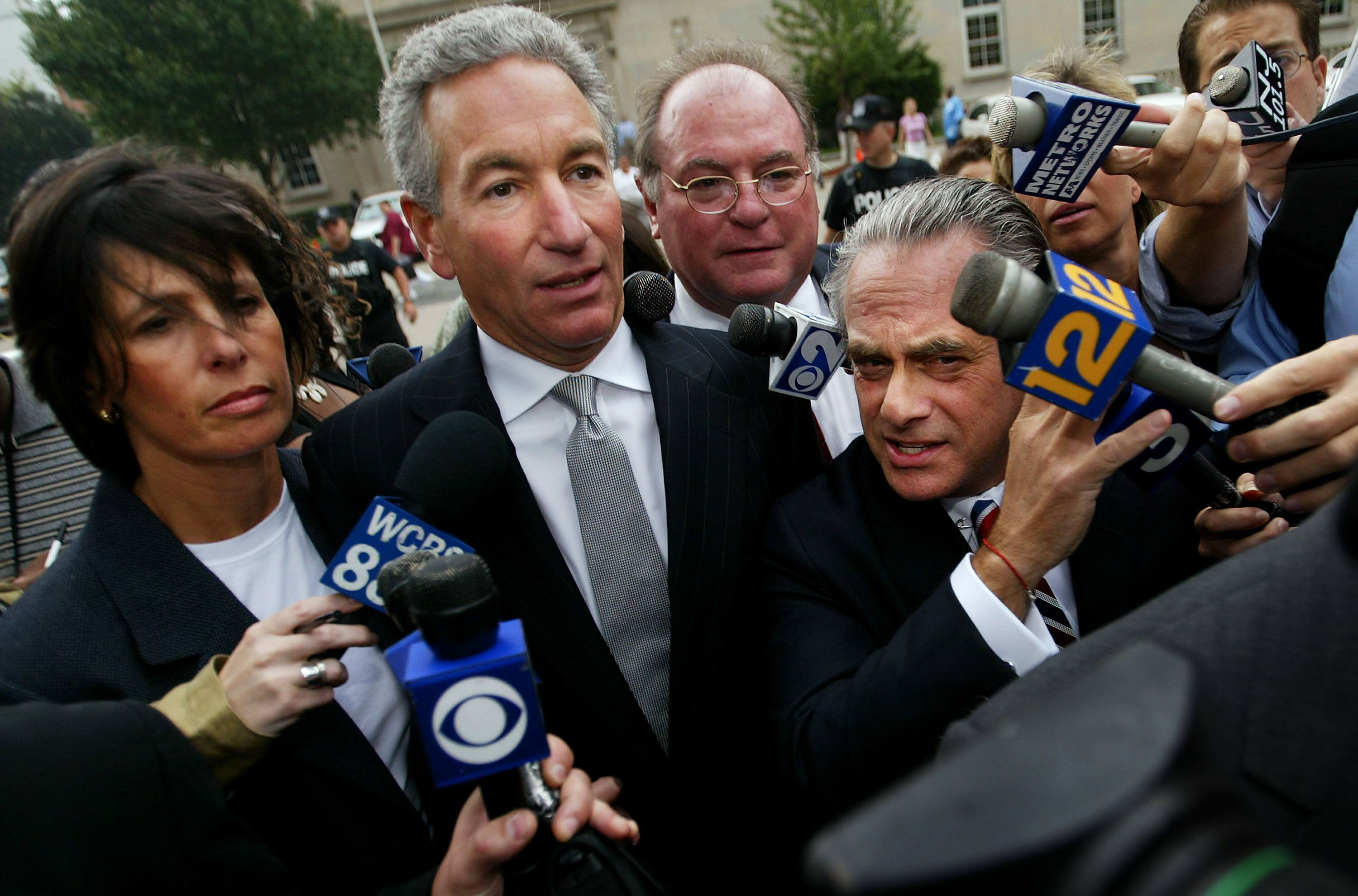 Charles Kushner (C) wades though the media with his legal team and wife