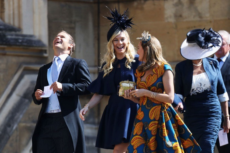 Prince Harry's ex, Chelsy Davy, smiles as she arrives at the royal wedding of Prince Harry and Meghan Markle