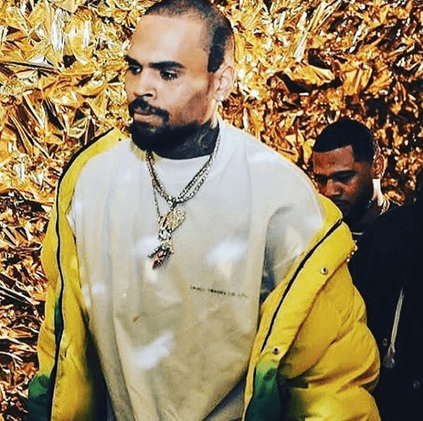 Chris Brown with shiny gold background