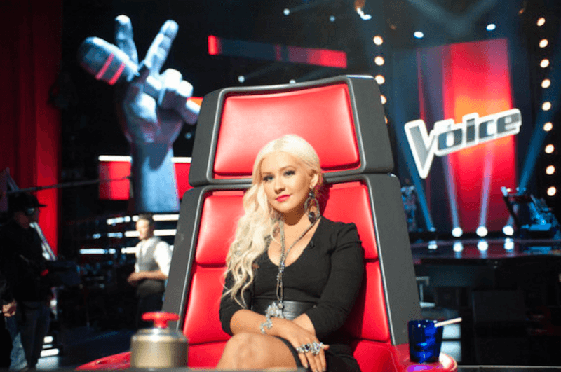 Christina Aguilera in her red chair